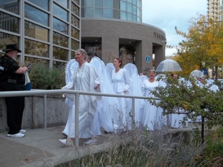 """A parade of """"Peace Angels"""" entering the Salt Palace."""